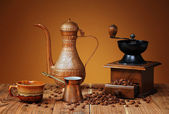 Coffee grinder and metal dishes — Stock Photo