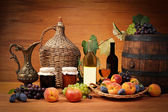 Fruit, jam and wine bottles — Stock Photo
