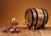 Wooden barrel, and plum brandy — ストック写真