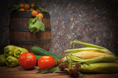 Vegetables and fruit with a wooden barrel — Stock Photo