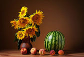 Sunflowers in a vase and watermelon — Stok fotoğraf