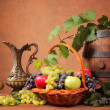 Wooden barrel and fresh fruit — Stock Photo #39341593