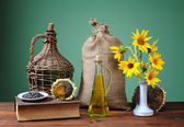 Sunflowers in a vase and a sack of jute — Stock Photo
