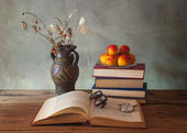Books and dried flowers — Stock Photo