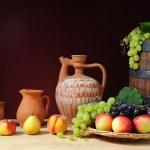 Fresh fruit, ceramic dishes — Stock Photo #44678197