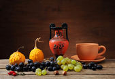 Grapes and pumpkins with ceramic jug — Stock Photo