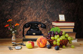 Old phone, fruit and books — Stok fotoğraf