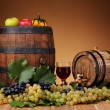 Fresh grapes, wooden barrel and a glass of wine — Stock Photo #46402373