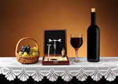 The wine in the bottle, accessories for opening wine and grapes — Stock Photo