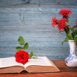 Open book, flower and rose ceramic vase — Stock Photo #48455133