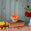 Sweet cherries, books and flowers in a vase — Stock Photo #48809477