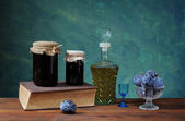 Plum jam in jars of glass, brandy and fresh fruit — Stock Photo