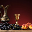 Metal carafe, grapes and peaches — Stock Photo #48930393