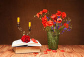 Red Poppy, book and candlestick — Stok fotoğraf