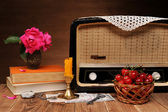 The old radio, flowers, books, and sweet cherries — Stock Photo