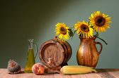 Sunflower oil and wooden barrel — Stock Photo