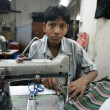 Young boy in textile factory — Stock Photo