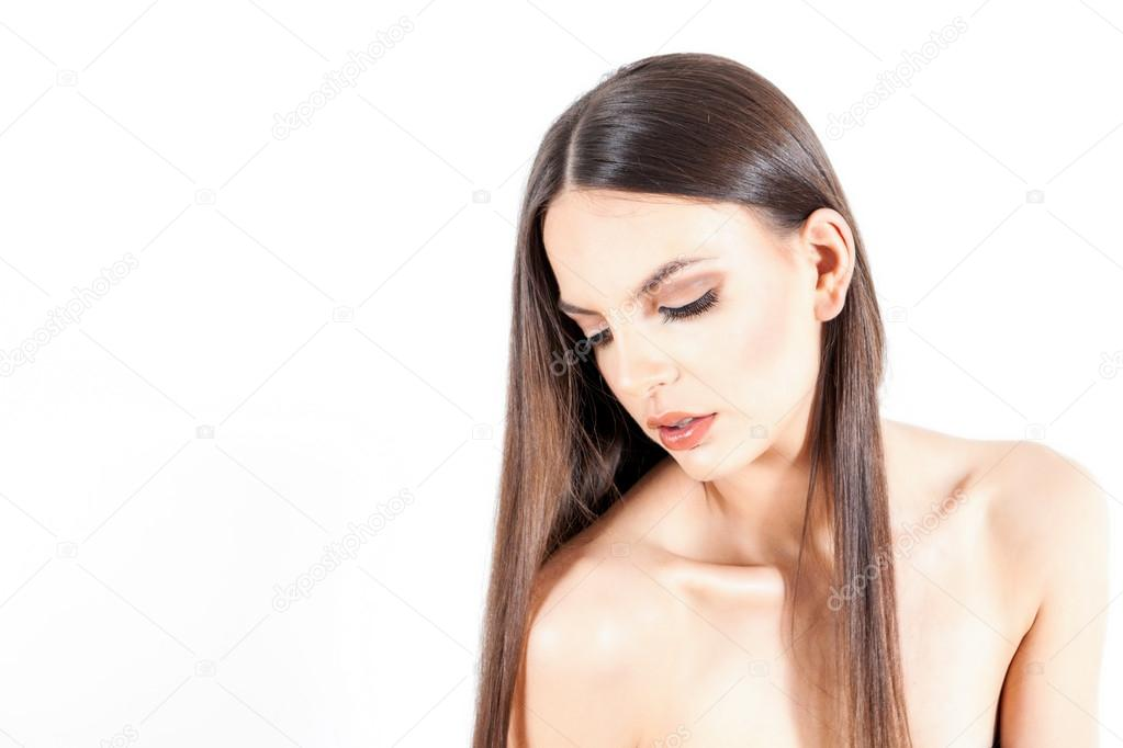 Portrait of young woman with long brown hair — Stock Photo #13437302
