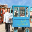 Stock Photo: Vendor on street next to standa
