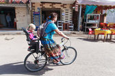 Woman on a bicycle with daughter — Stock Photo