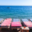 Stock Photo: Loungers on beach