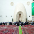 Afternoon prayer in mosque - Stock Photo