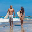 Young couple walking on beach — Stock Photo #18567243