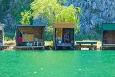 Fishing lodges and fisherman — Stock Photo