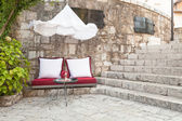 Seat cushions and a coffee table in Mostar — Stock Photo