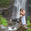 Couple at waterfall — Stock Photo