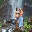 Couple at waterfall — Stock Photo #22525331