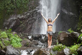 Woman at waterfall — Stock Photo