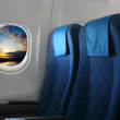 Airplane seat and window — Stock Photo #22834744