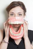 Woman false teeth — Stock Photo
