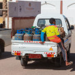 Small trucks deliver gas bottle — Stock Photo