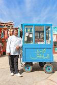 Vendor on the street next to stand — Stock Photo