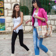 Two girls walk on Bascarsija — Stock Photo
