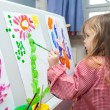 Stock Photo: Little girl painting on paper