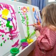 Little girl painting on paper — Stock Photo