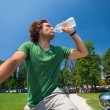 Man on bicycle drinking water — Stock Photo #39406623