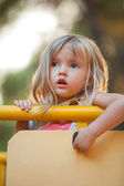 Little blond girl in park — Stock Photo