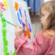 Little girl painting on paper — Stock Photo #44160659