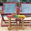 Two empty red deckchairs at sandy beach. — Stock Photo