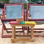 Two empty red deckchairs at sandy beach. — Stok fotoğraf