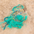 Part of the fishing net on the sandy beach. — Stock Photo