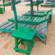 Group of empty green sunbeds at sandy beach. — Stock Photo