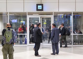 People in and in front of the smoking room at Doha International Airport — Stock Photo