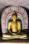 Big  golden Buddha statue inside of Dambulla cave temple — Stock Photo