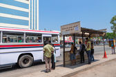 Local people on bus station waiting for bus. — Stock Photo