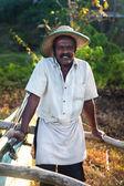 Local fisherman posing by his boat — Foto de Stock